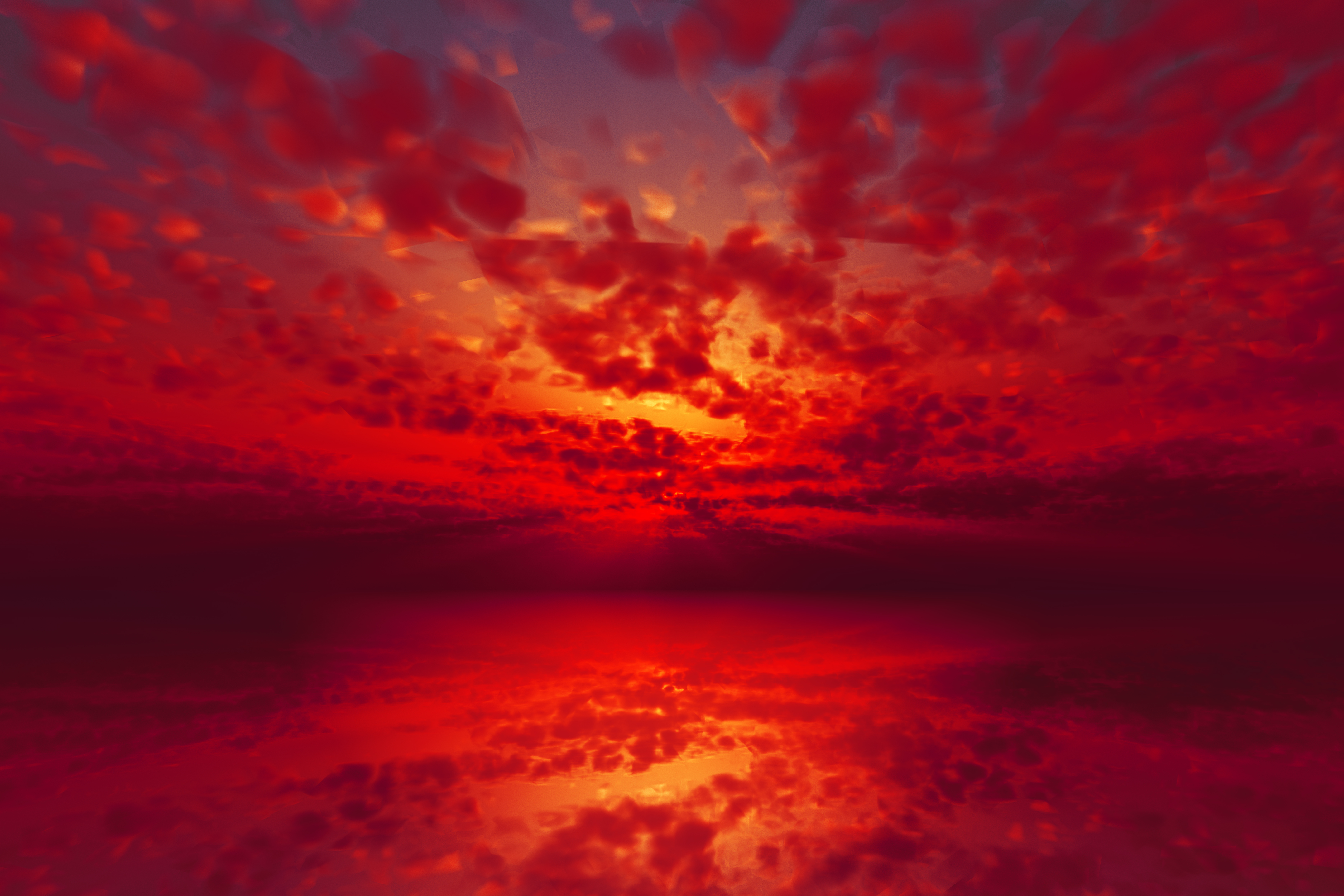 Fiery red and orange sunset with red clouds reflected in the water